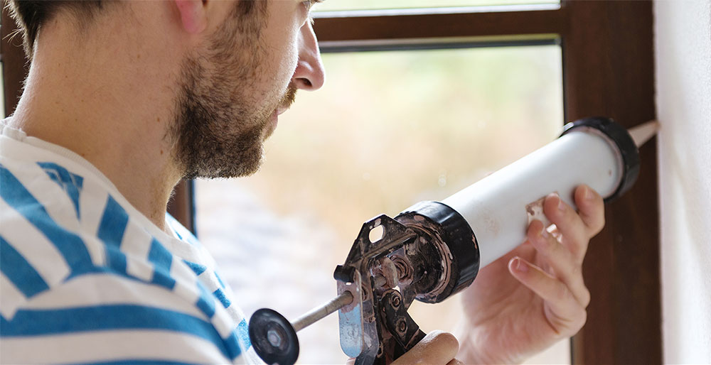 caulking a window | Tashman Home Center